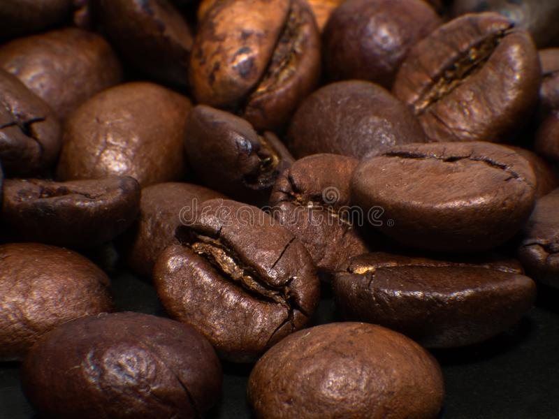 Close-up of roasted coffee beans. Macro photo coffee beans on black stock photo
