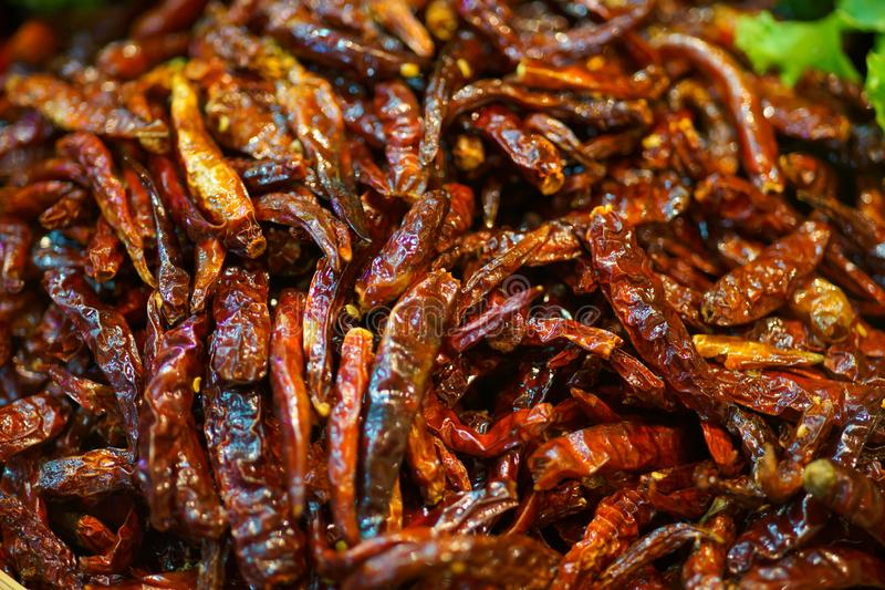Close up Roasting dried chilli at thailand street food market stock photography