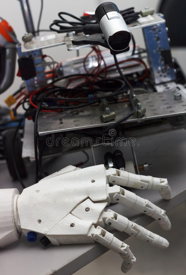 Close up of robot hand on table with details at background. Concept of future technology royalty free stock image
