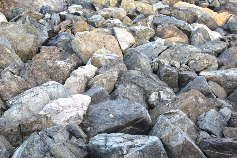Close up of rocky shore texture background- 22 JULY 2017. royalty free stock photography