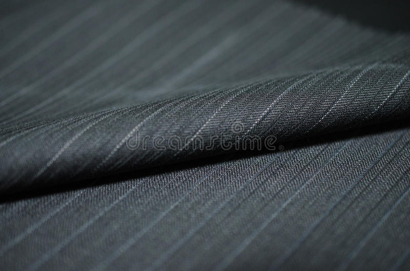 Close up roll black blue shade fabric of suit stock photography