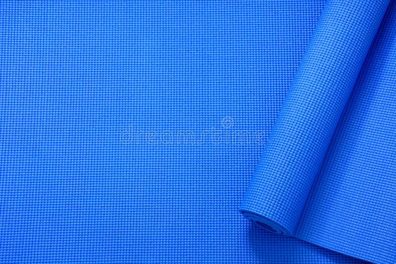Close up roll blue color yoga mat texture background,top view, copy space, healthy lifestyle, sport and exercise concept stock photos