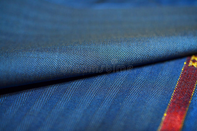 Close up roll blue texture stripe line black of suit. Photo shoot by depth of field for object stock image