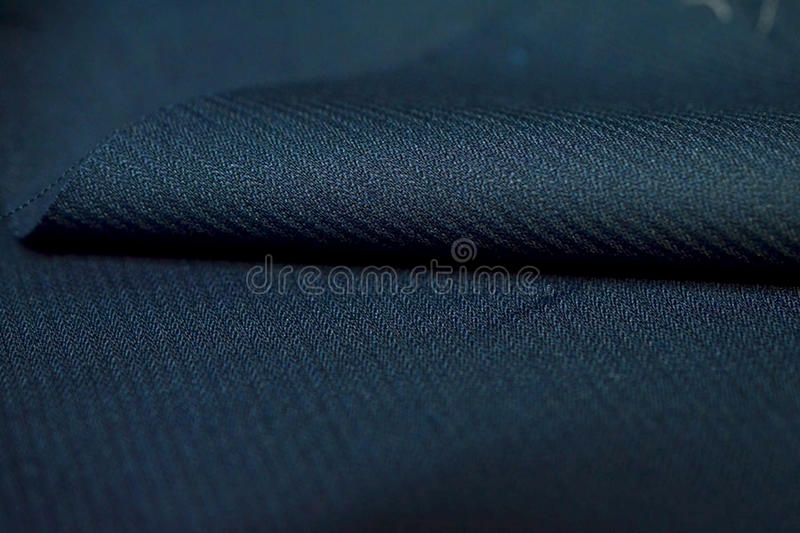 Close up roll dark blue stripe pattern texture of suit. Photo shoot by depth of field for object royalty free stock photos