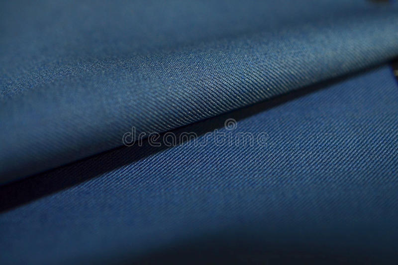 Close up roll striped dark blue fabric of suit. Photo shoot by depth of field for object royalty free stock photo