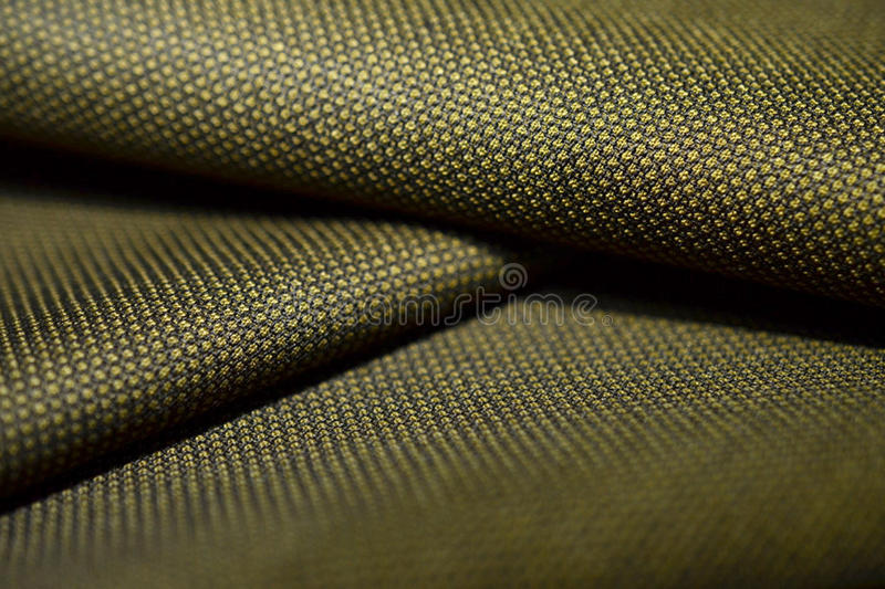 Close up roll texture gold with black pattern of suit. Photo shoot by depth of field for object stock photography