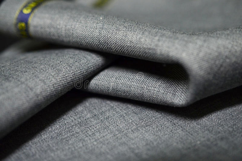 Close up roll texture gray fabric of suit. Photo shoot by depth of field for object stock photos