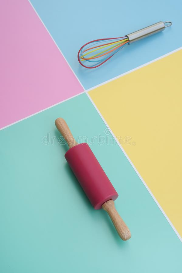 Close up of rolling pin and whisk. For background stock photo