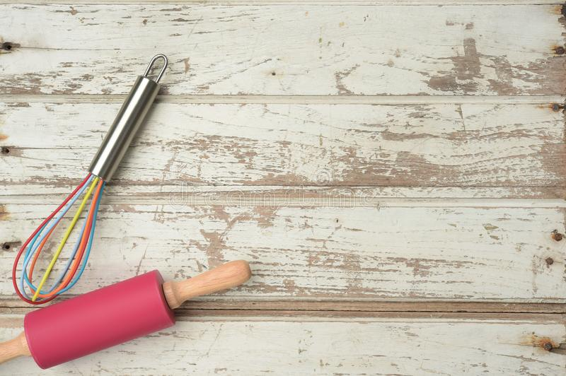 Close up of rolling pin and whisk. For background stock photos
