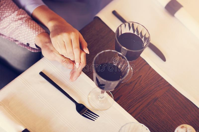 Couple eating romantic Dinner in a gourmet restaurant drinking wine and eating. Close-up of romantic Dinner in a gourmet restaurant couple drinking wine and stock image