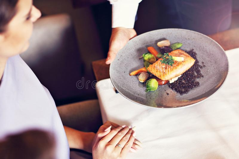 Couple eating romantic Dinner in a gourmet restaurant drinking wine and eating. Close-up of romantic Dinner in a gourmet restaurant couple drinking wine and stock photos