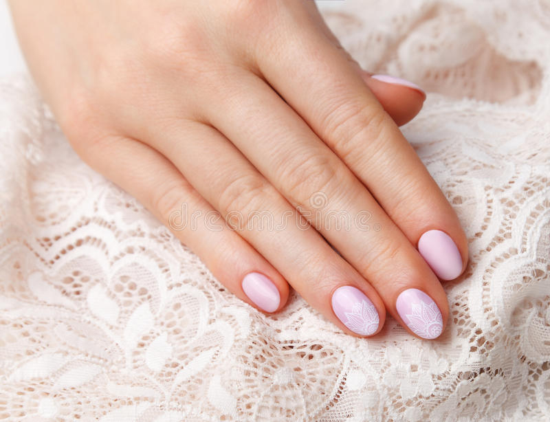 Close-up of romantic vintage style nails. Close-up of romantic vintage style baby pink nails made with gellac stock image
