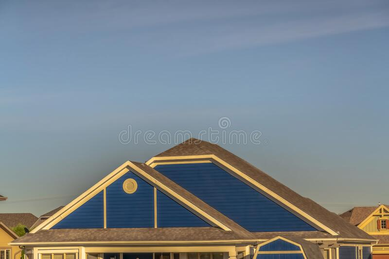close up roof structure home blue gable wall round gable window home exterior roof design viewed against cloudy 168772836