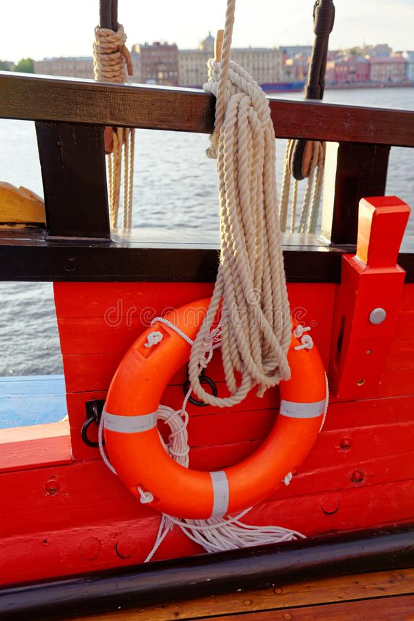 Close up of a rope and lifebuoy on a old wooden ship. Details deck of the saiilboat royalty free stock photos