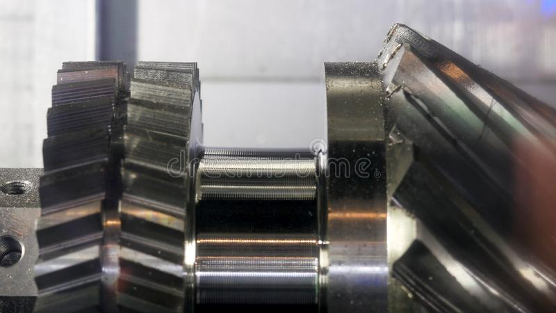 Close up for the rotating new metal gear at the factory, industrial concept. Media. Metal machine parts production. royalty free stock photos