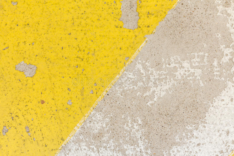 Close-up of rough speed bump in yellow and black color texture, stock photo