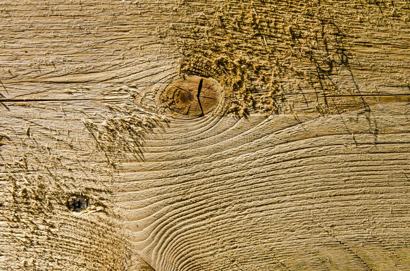 Rough wooden surface with knot and annual rings stock photography