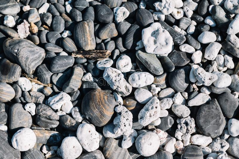 Close up of rounded beach stones and pebble stones. stock photography