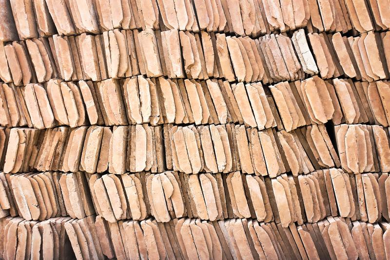 Row of brown clay roof tiles patterns texture or background. Close up Row of brown clay roof tiles patterns texture or background stock photos