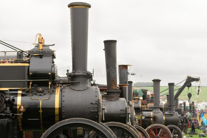 Traction engines at a steam fair. Close up of a row of traction engines at a steam fair royalty free stock photos