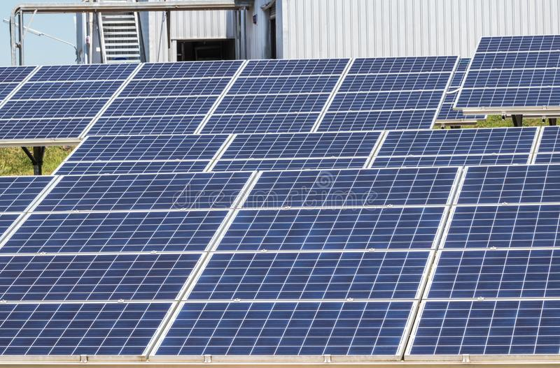 Close up rows array of polycrystalline silicon solar cells or photovoltaics cell in solar power plant station. Alternative renewable energy stock images