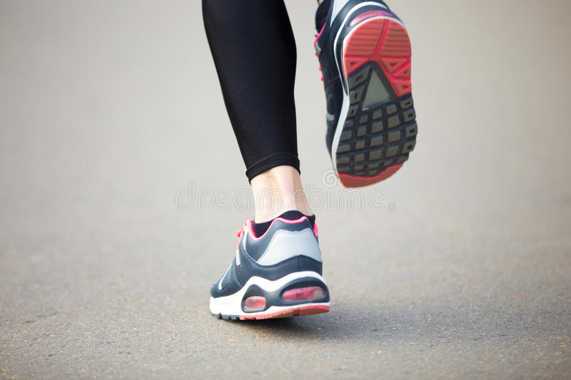 Close-up of runner woman feet. Back view stock photos