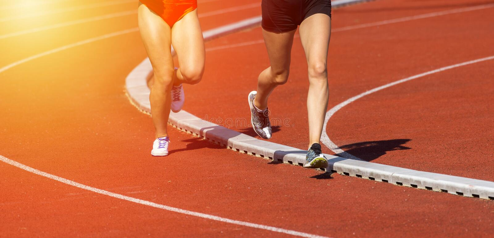 Close up of runners feet on the track field royalty free stock images
