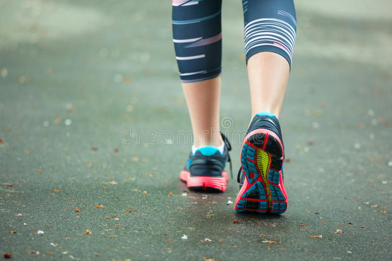 Close up of running shoes on road. royalty free stock photo