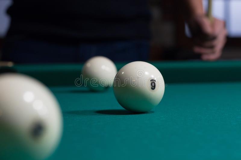 Russian billiards balls on green game table and player royalty free stock images