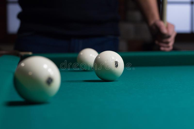 Russian billiards white balls on game table and player royalty free stock images