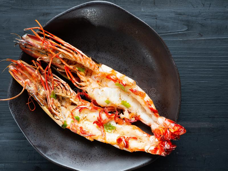 Rustic grilled jumbo prawn stock photos