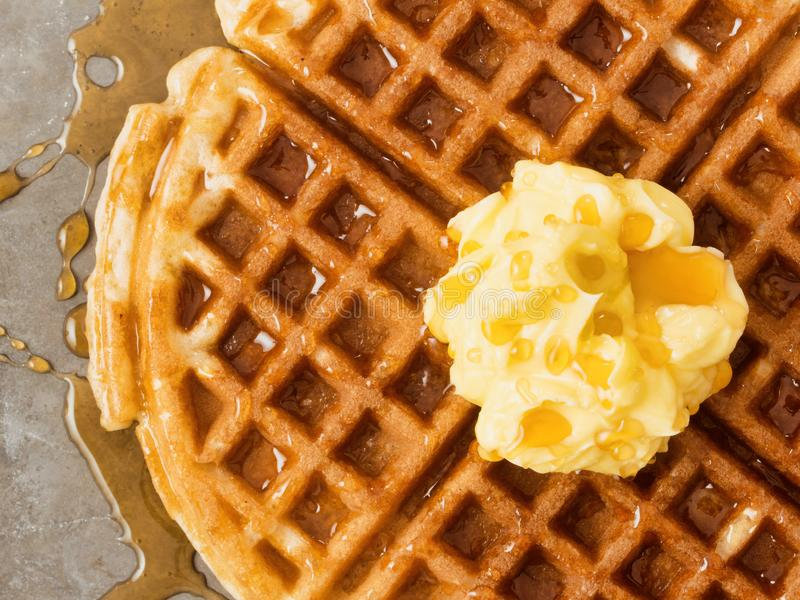 Rustic traditional waffle with butter and maple syrup stock photos
