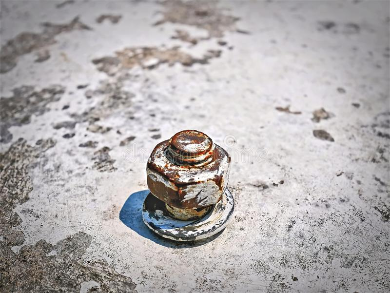 Close-up Bolt, Nut and Washer on Concrete Floor stock photos