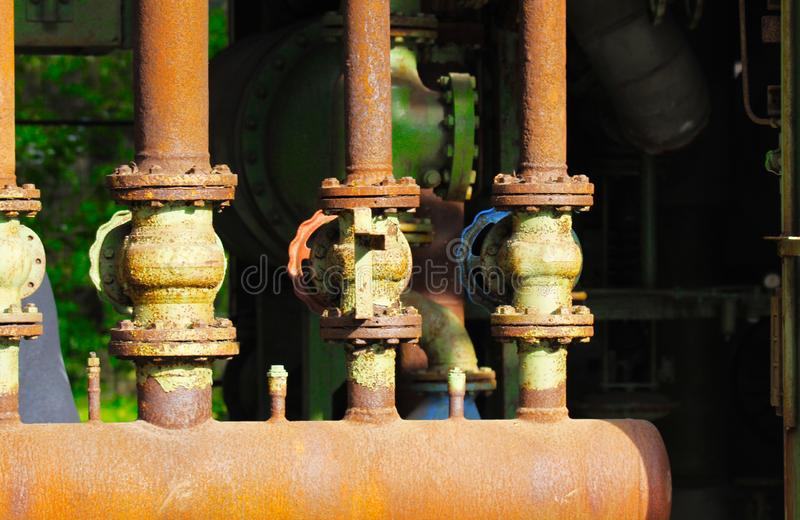 Landschaftspark Duisburg, Germany: Close up of rusty corroded tube construction with valves royalty free stock photography