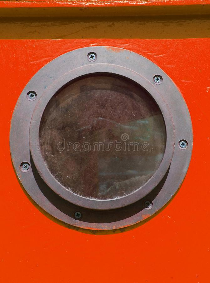 close up of rusty metal vintage porthole on a red wooden boat stock photos