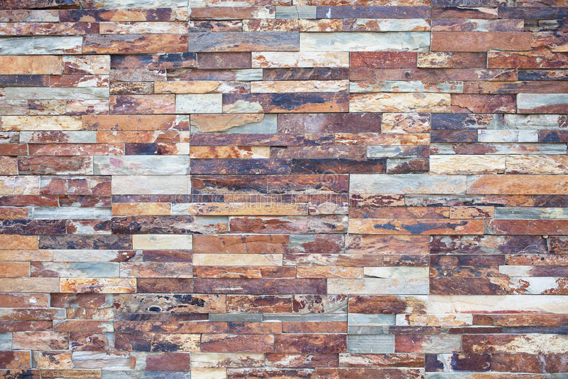 Close-up of rusty Stone. Stone Veneer for Exterior Wall Decor. Rusty Stone. Stone Veneer for Exterior Wall Decor. Rusty Stone Wall Decor, Slate Thin Stone royalty free stock photo