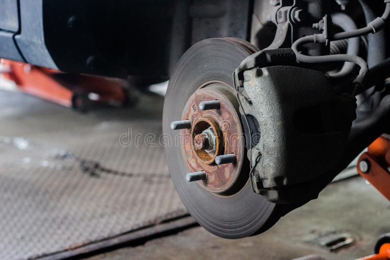 Rusty wheel in changing tire service. stock photos