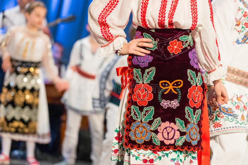 Close up s of young Romanian dancers perform a folk dance in traditional folkloric costume. Folklore of Romania.  royalty free stock image