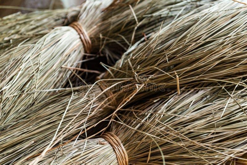 Close-up on sacks of straws for sedge mat weaving in Ben Tre, Mekong delta region, Vietnam. Horizontal view. Close-up on sacks of non-dyed straws for sedge mat royalty free stock photography
