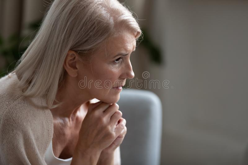 Close up of sad mature female feel lonely at home royalty free stock images