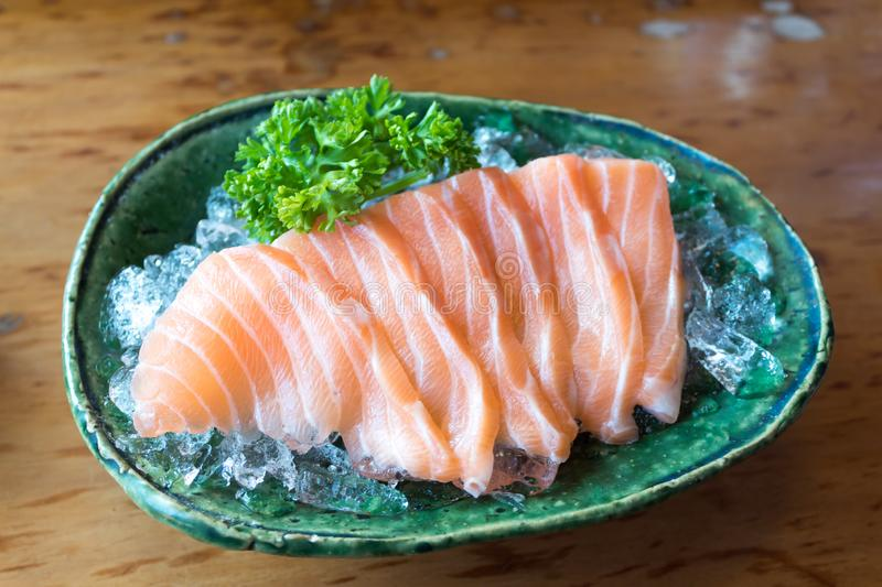 Close up of salmon, sashimi, japanese food. On the ice bowl stock photos