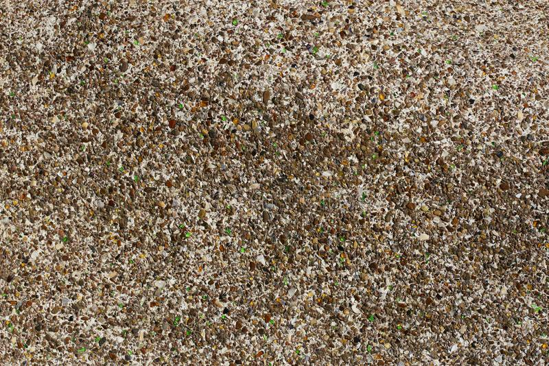 Background of small pebbles, colored glass fragments and pieces of sea shells. royalty free stock photography