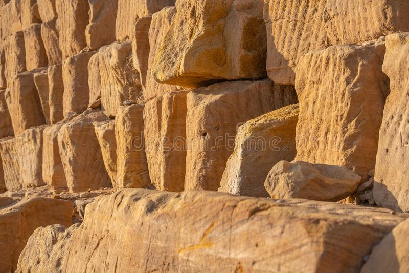Close-up of the sandstones used to build the pyramids of the black pharaohs in Sudan, abstract. Close-up of the sandstones used to build the pyramids of the stock photography