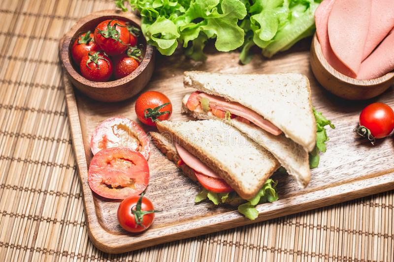 Close up of sandwiches and ham with tomatoes,Club sandwich with cheese and vegetable. A bread food in breakfast royalty free stock image