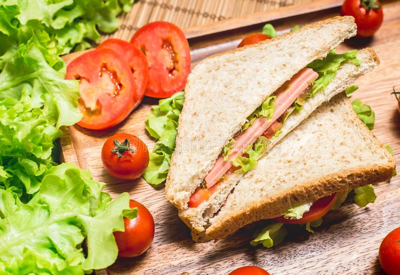 Close up of sandwiches and ham with tomatoes,Club sandwich with cheese and vegetable. A bread food in breakfast royalty free stock photography