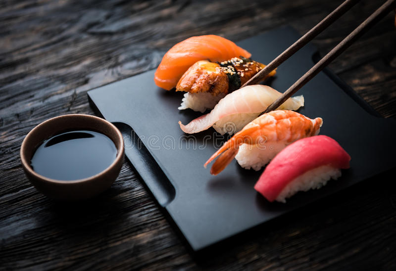 Close up of sashimi sushi set with chopsticks and soy royalty free stock photo