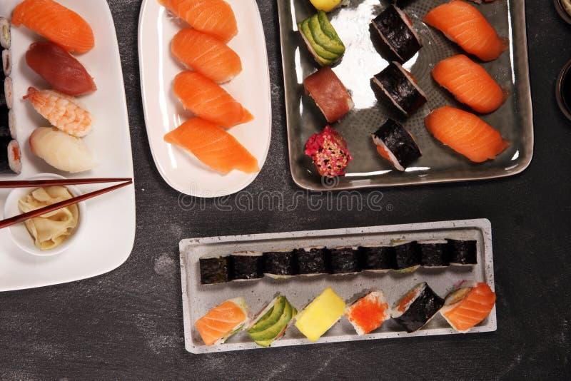 Close up of sashimi sushi set with chopsticks and soy - sushi roll with salmon and sushi roll with smoked eel. Selective focu.s stock photography