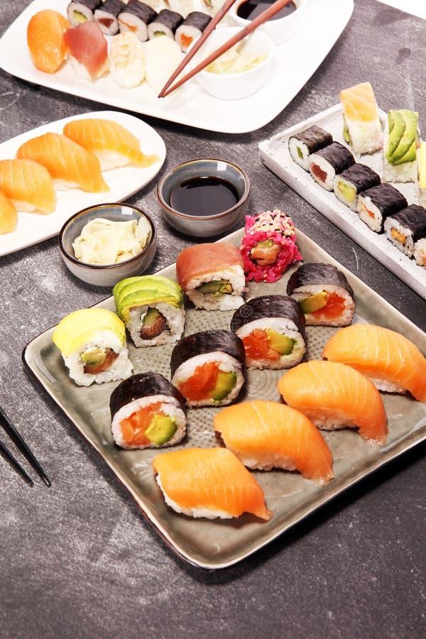 Close up of sashimi sushi set with chopsticks and soy - sushi roll with salmon and sushi roll with smoked eel. Selective focus royalty free stock photos