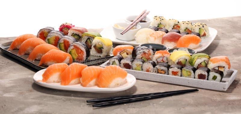 Close up of sashimi sushi set with chopsticks and soy - sushi roll with salmon and sushi roll with smoked eel. Selective focus stock image