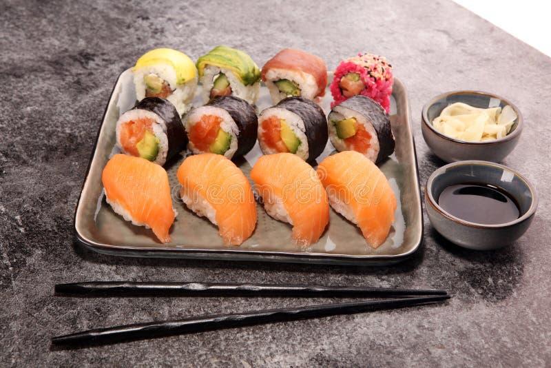 Close up of sashimi sushi set with chopsticks and soy - sushi roll with salmon and sushi roll with smoked eel. Close up of sashimi sushi set with chopsticks and stock image